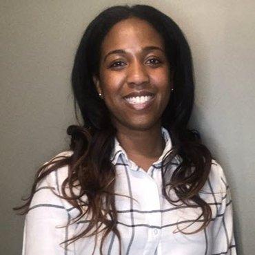 Alexandria Caldwell of the Kansas City Fed smiling at the camera